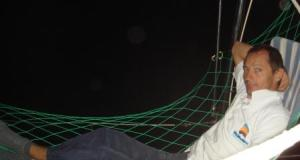 Marc in a hammock at night