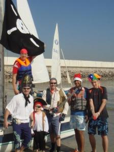 School team pirates stand on boat