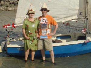 Vicky and Chris in front of single hulled boat