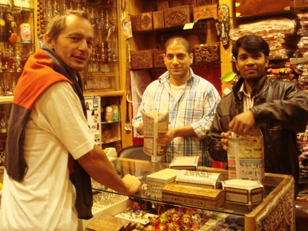 Marc in Souk with guys wrapping the boxes.