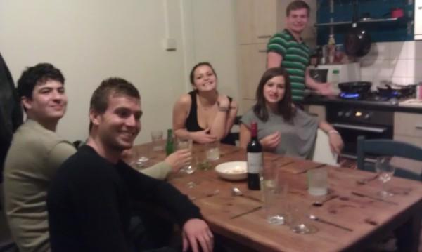 Five students around kitchen table
