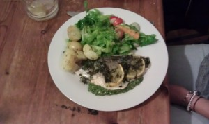 Plate of fish, potatoes and salad.