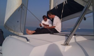 Marc and Farid on Coachroof of catamaran